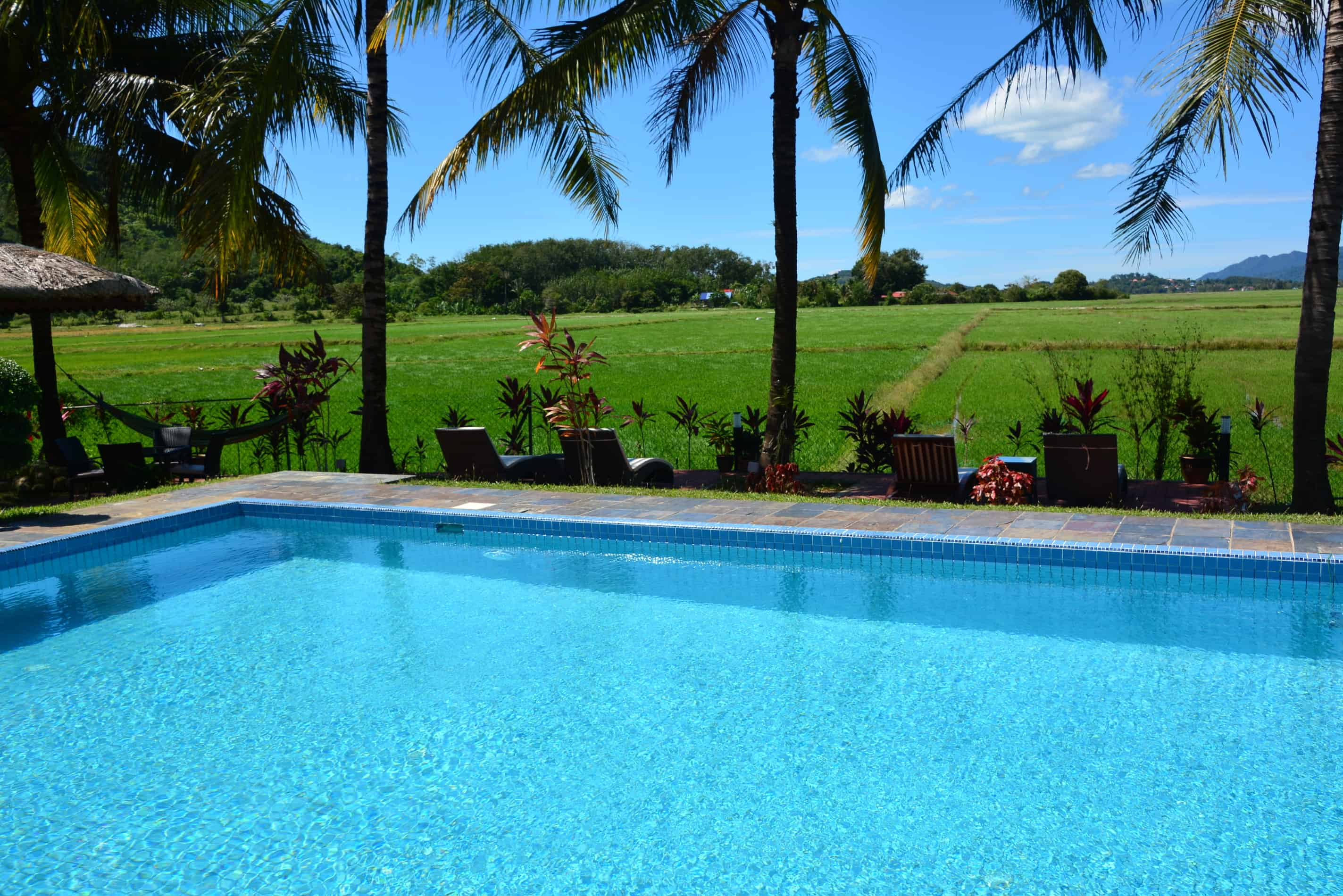 Sunset Valley Holiday Houses - Pool with rice paddy view